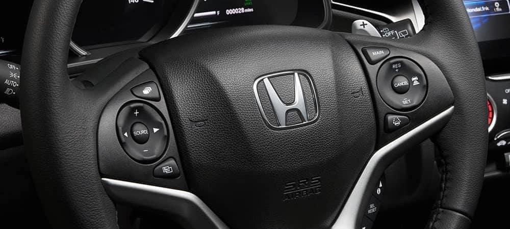 Close on 2020 Honda Fit steering wheel with Honda logo