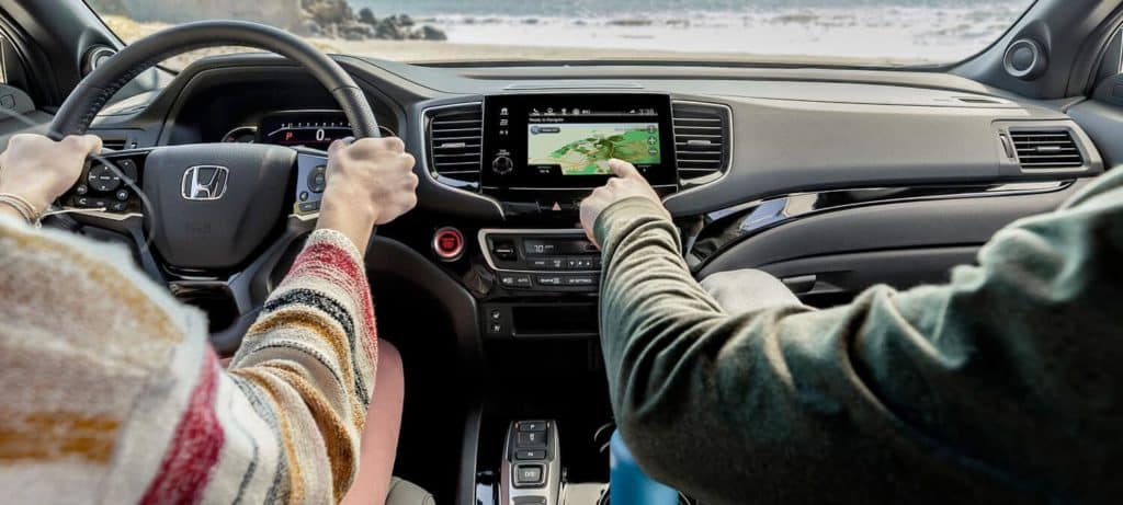 People in front seats of 2020 Honda Passport AWD