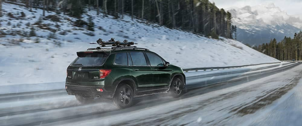 2020 Honda Passport driving on snowy highway