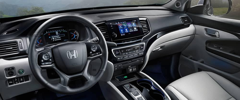 2020 Honda Pilot Dashboard with empty front seats and technology console