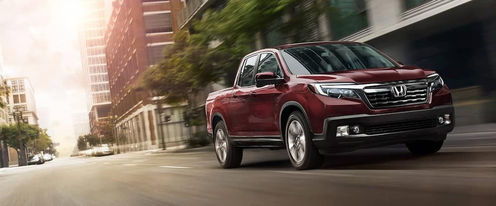 Red 2020 Honda Ridgeline driving on road