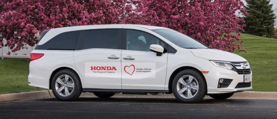 White Honda Odyssey customized for COVID-19 testing in Detroit