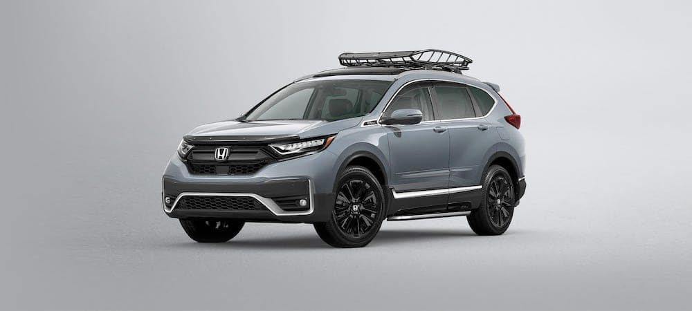 Silver 2020 Honda CR-V with roof rack against gradient background