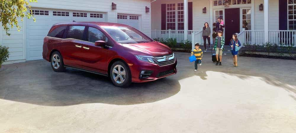 Family walking out house to red 2020 Honda Odyssey parked in driveway