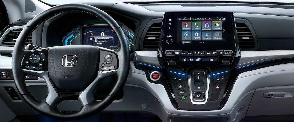 Close on Odyssey dashboard with wheel and infotainment console
