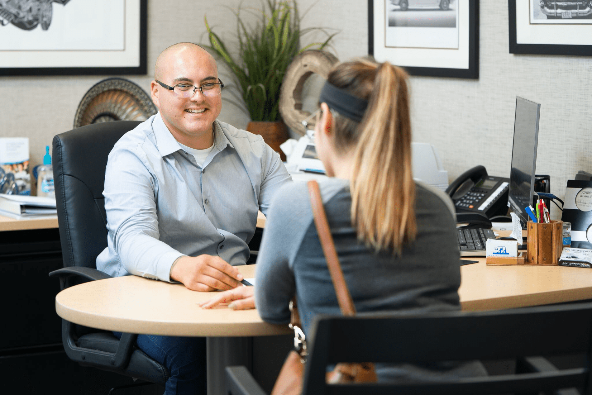 finance officer meets with customer at desk