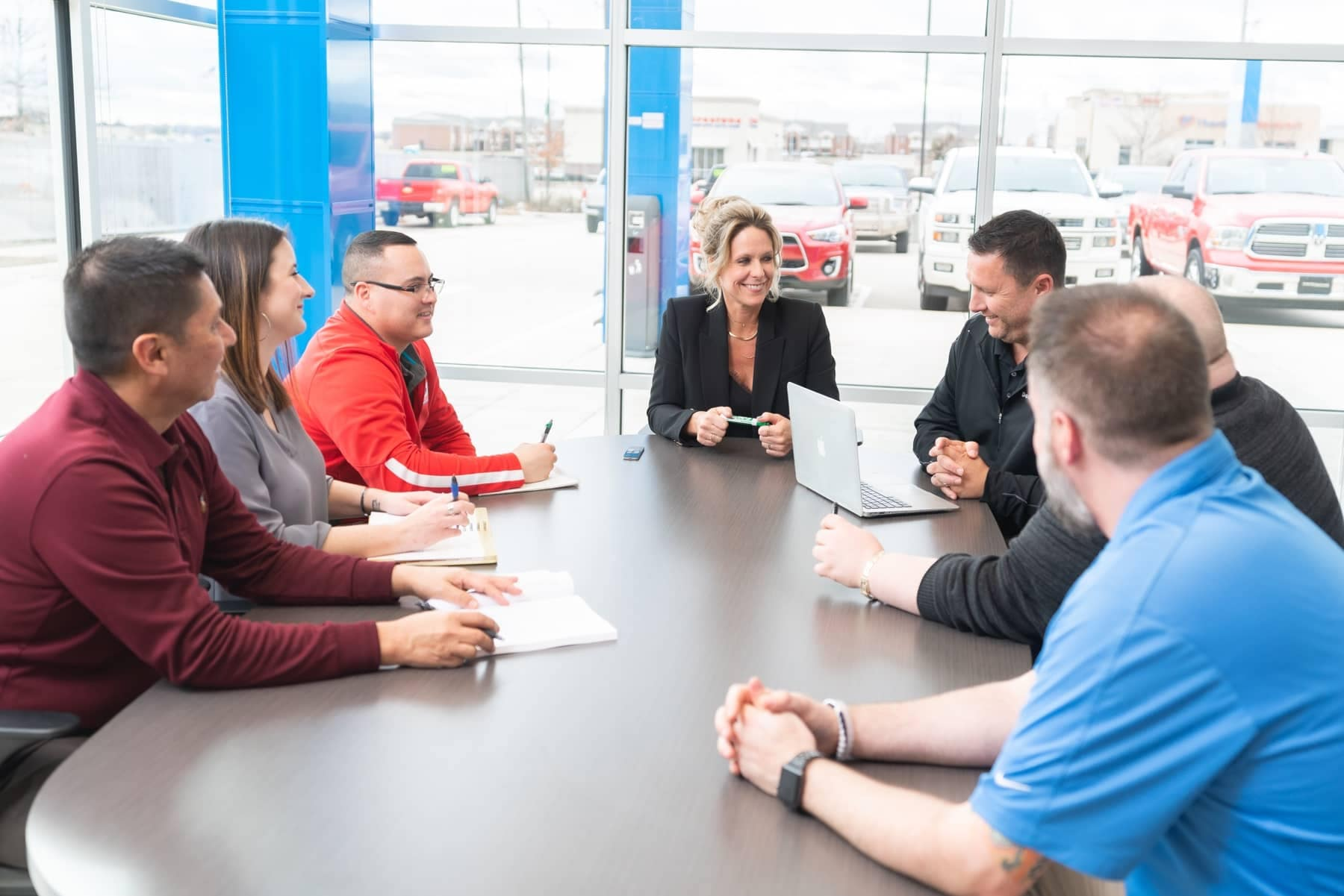 staff meeting in a car dealership