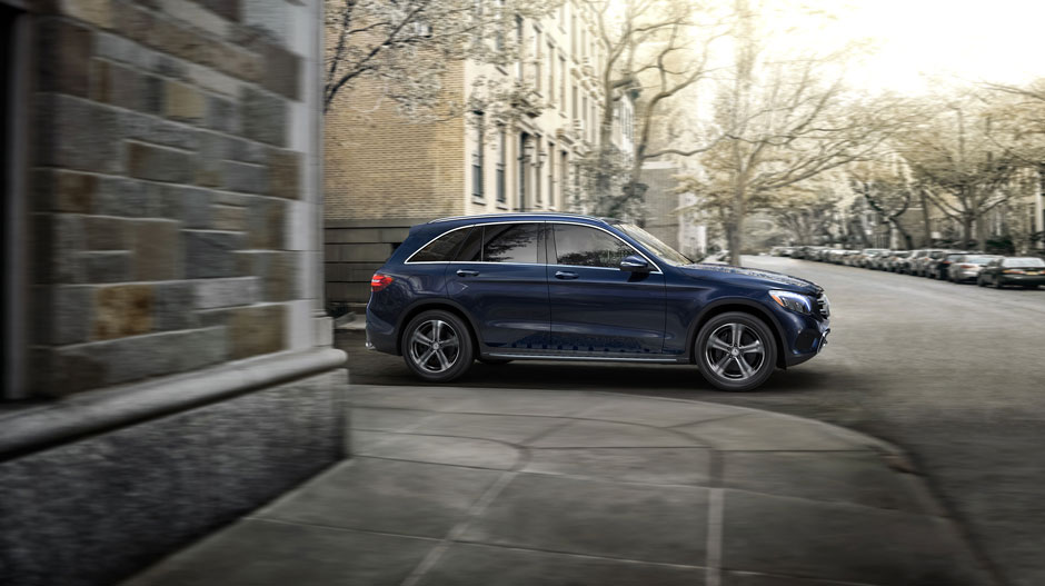 A blue GLC300 pulling out of an alley in the city