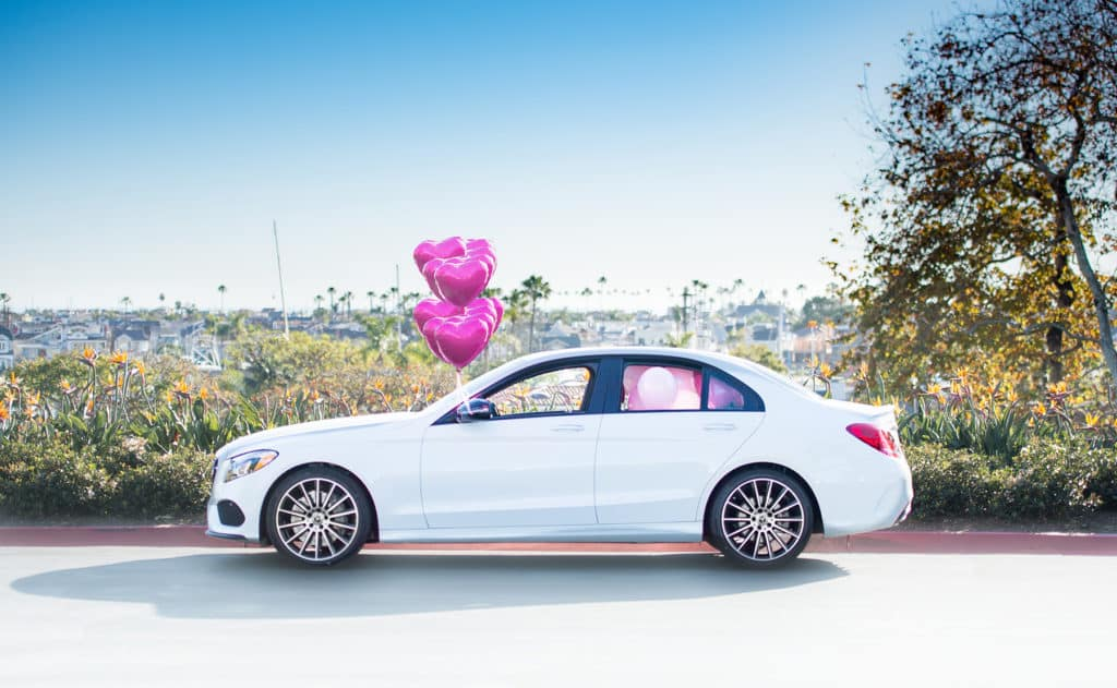 heart balloons and white Mercedes-Benz C 300