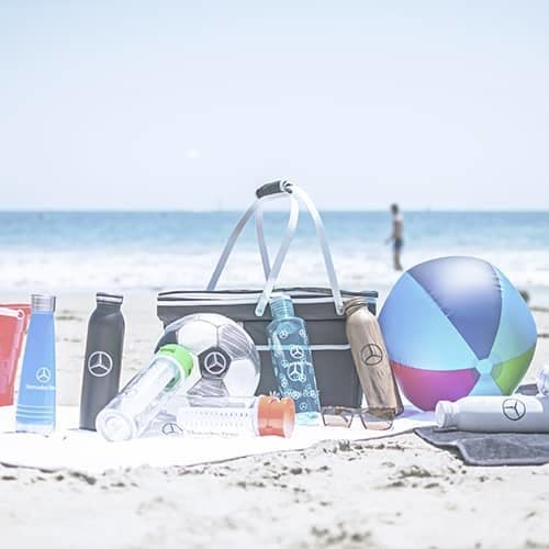 Several MB branded products on a beach