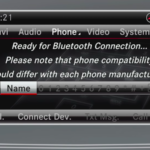 Bluetooth-equipped smartphone next to Mercedes-Benz Bluetooth setup display