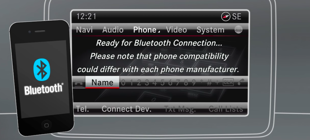 Bluetooth-equipped smartphone next to Mercedes-Benz Bluetooth setup display