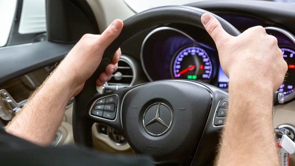 Hands on a Mercedes-Benz Steering Wheel