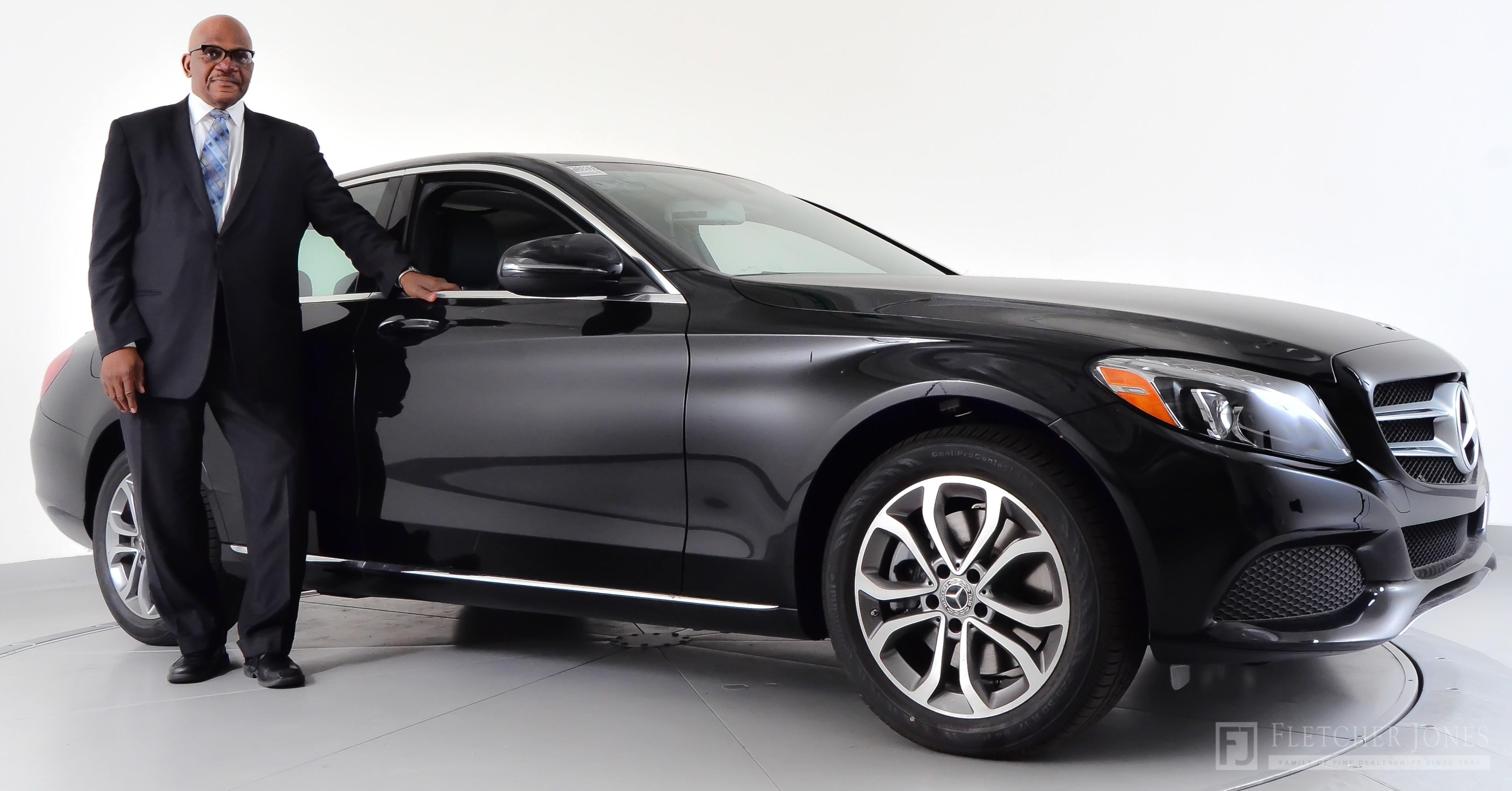 Jim Jordan standing next to a Mercedes-Benz C 300 Sedan