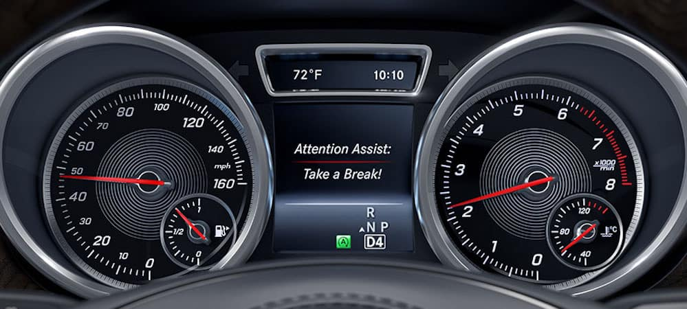 Mercedes-Benz ATTENTION ASSIST feature displayed on gauge cluster