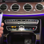 Hand holding an Android phone getting ready to be paired with Mercedes-Benz system