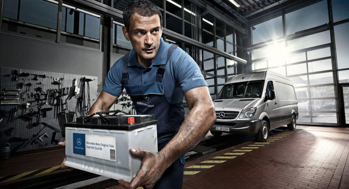 Mercedes-Benz service technician with replacement battery