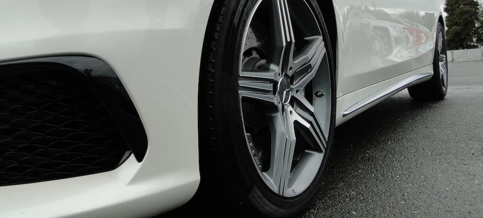 Closeup of front tire on white Mercedes-Benz
