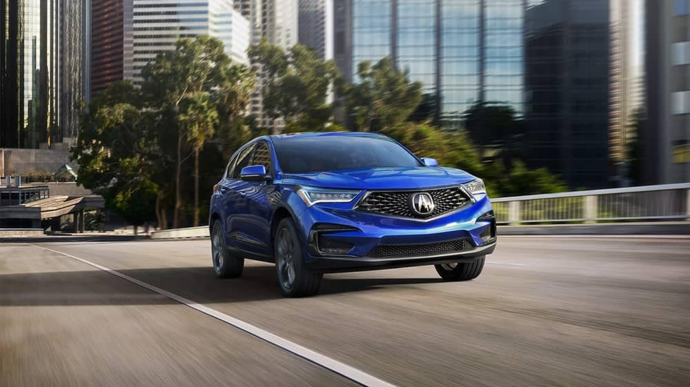 2019 Acura RDX in blue driving in the city