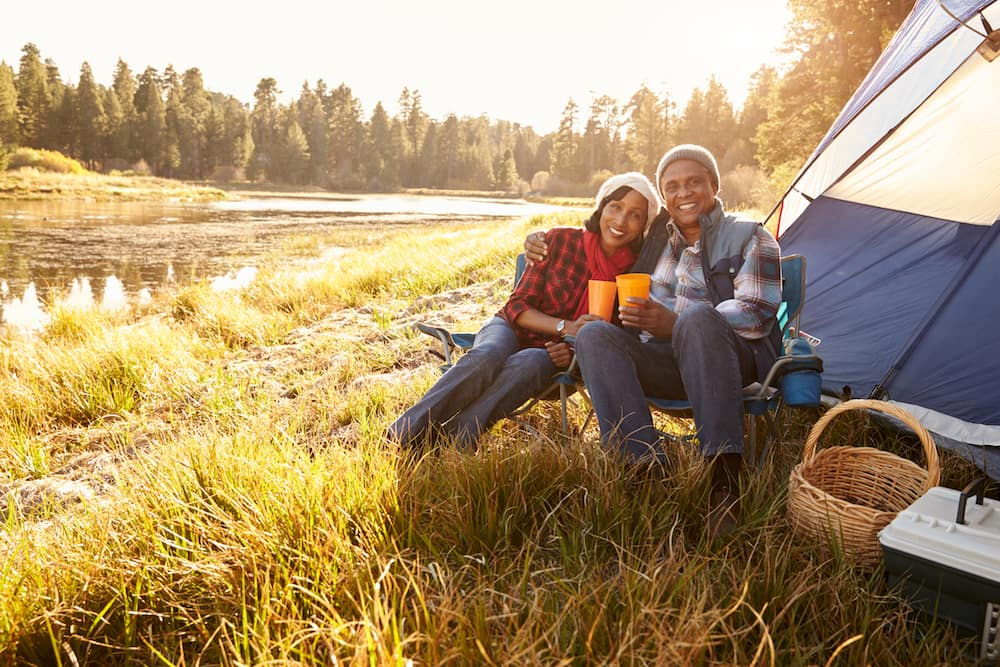 Portrait Of Senior Couple On Autumn Camping Trip