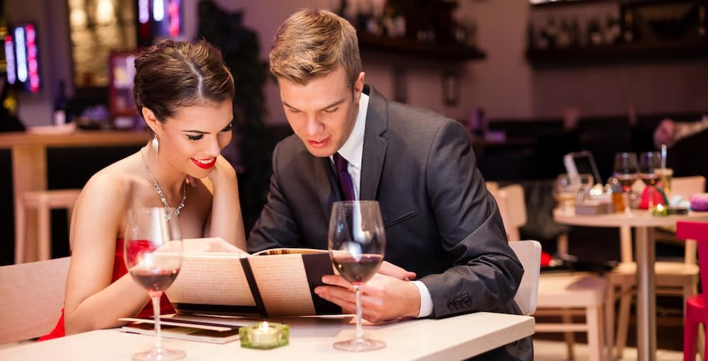 Young couple enjoying a romantic dinner with wine