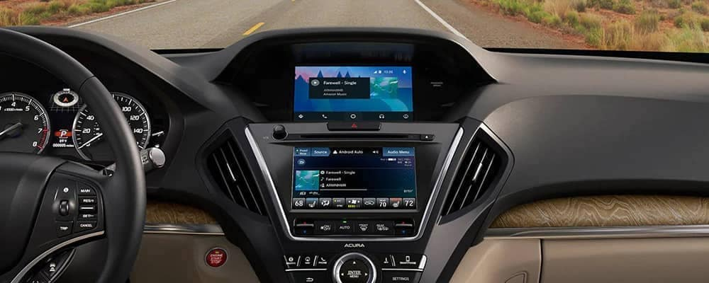 View of 2020 Acura MDX dashboard with center console and road in background