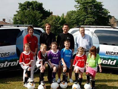 """MOVING KIDS WITH THE FIELD PATROL - The Hickman Automotive Group has come on board again this year as a major sponsor of the Aliant St. John's Youth Soccer Program. Hickman will provide the vehicles used to transport equipment to and from the fields throughout the summer.    Thousands of kids play in the City of St. John's Youth Soccer League. """"Field Patrol"""" vehicles help smooth the way for those who wish to get involved in a staff role but may not have access to a vehicle. They are also the main sponsor of """"Skills and Drills"""", which allows participants to hone their soccer abilities through various drill exercises. We at Hickman Automotive Group are proud to support programs that directly influence our youth. Programs such as this one allow our youth to participate in fun filled recreational activity and help them to develop important character building principles, and of course, to have fun."""