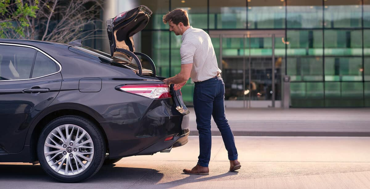 man in trunk of 2018 Toyota Camry image