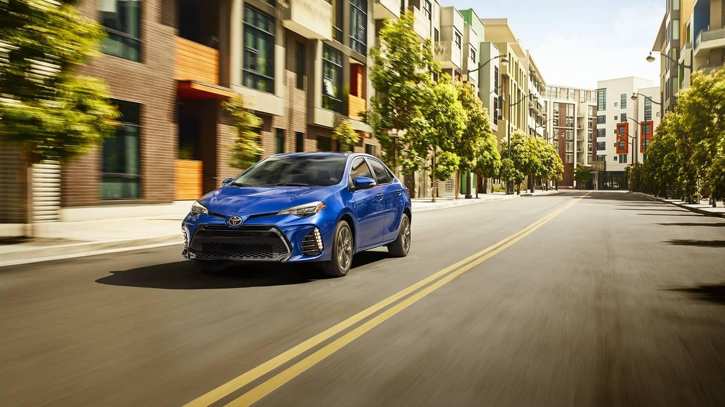 Blue 2018 Toyota Corolla SE on city street