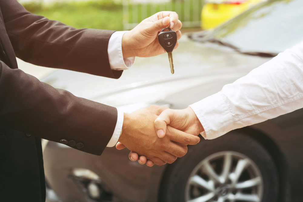 handing over the keys for a used car