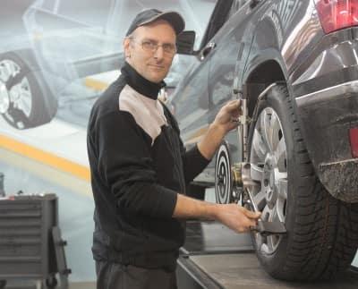 Man repairing tires near Madisonville KY