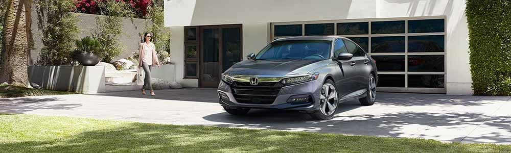 Honda Accord in front of house