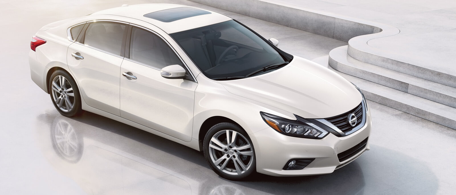 2016 Nissan Altima white exterior on display