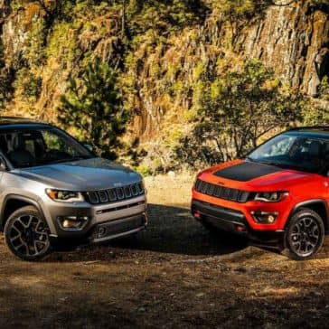 2018 Jeep Compass parked next to Jeep Cherokee