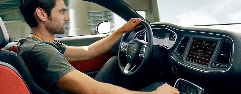 man driving 2018 Dodge Challenger