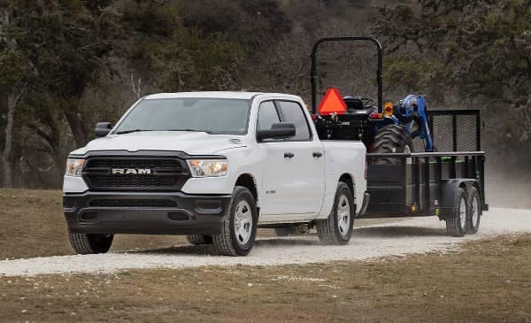 2019 Ram 1500 Trademan towing a small trailer with equipment