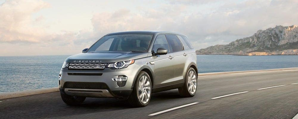 2019 Land Rover Discovery Sport in gray driving on coastal highway