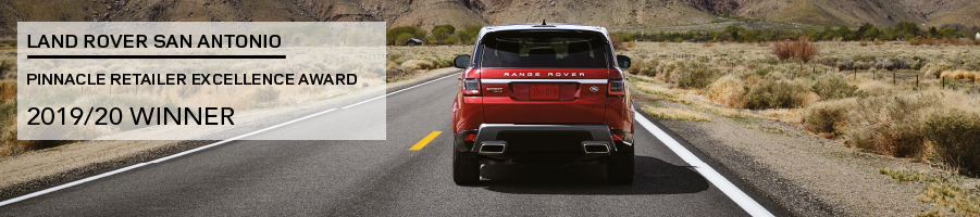 LAND ROVER SAN ANTONIO. PINNACLE RETAILER EXCELLENCE AWARD. 2019/20 WINNER. RED RANGE ROVER SPORT DRIVING DOWN ROAD NEAR MOUNTAINS.