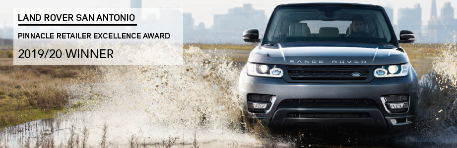 LAND ROVER SAN ANTONIO. PINNACLE RETAILER EXCELLENCE AWARD. 2019/20 WINNER. GRAY RANGE ROVER SPORT DRIVING THROUGH PUDDLE.