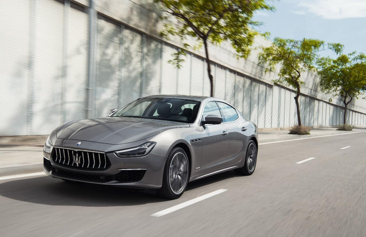 Gray 2019 Maserati Ghibli V6 GranLusso driving past trees on a highway