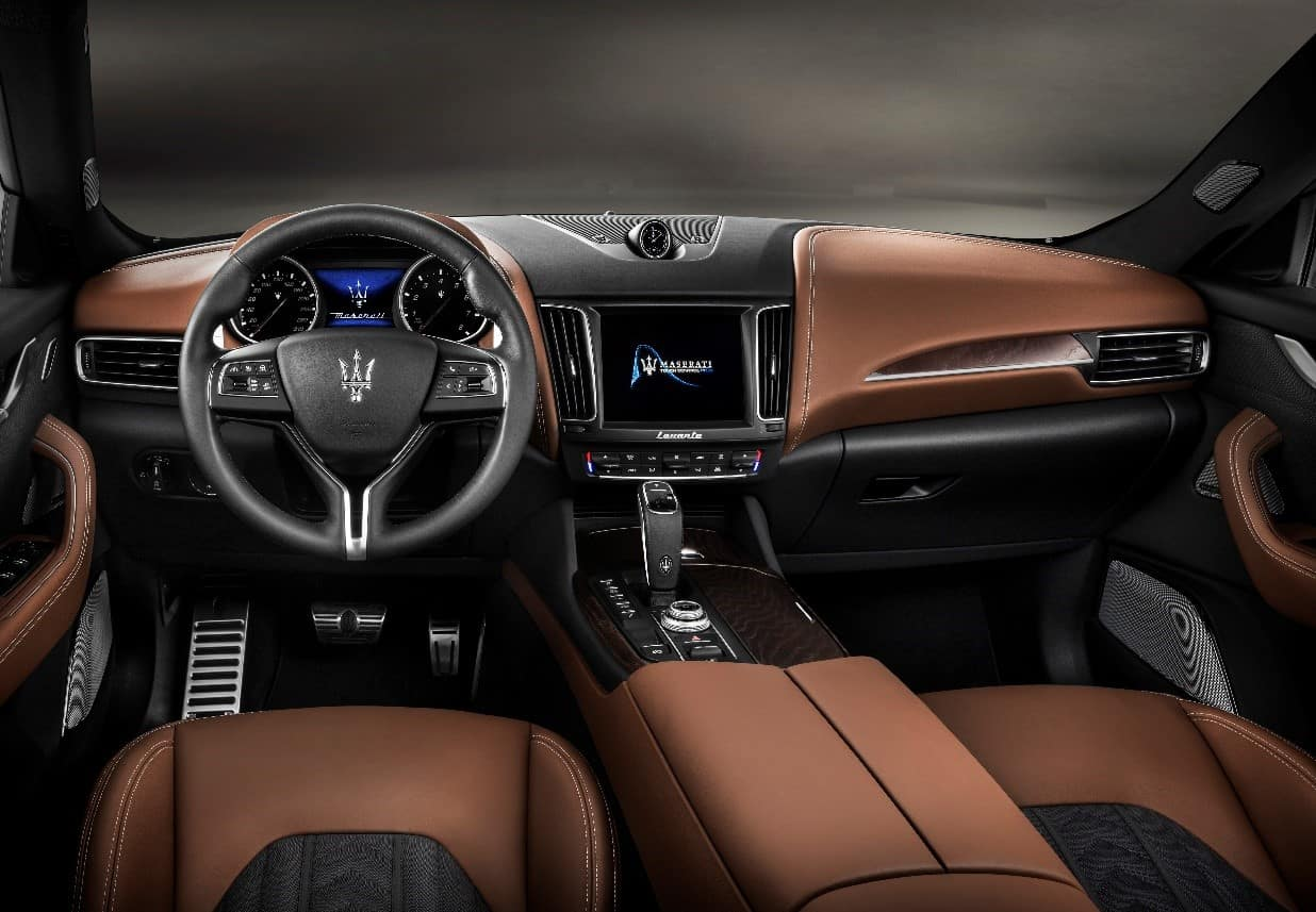 Black and brown two-tone interior of a 2019 Maserati Levante V6 GranLusso showing infotainment center