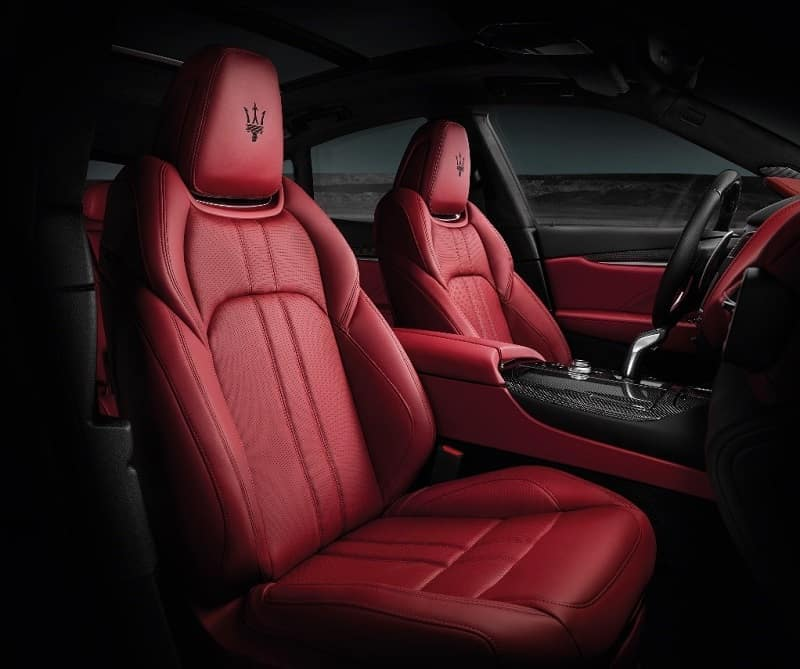 Interior shot of a 2019 Maserati Levante GTS SUV with red leather seats and black accents