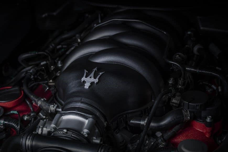 Black and red V8 Maserati GranTurismo engine featuring a chrome Trident logo