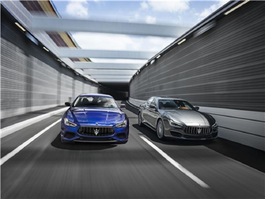blue 2018 Maserati Ghibli Range driving next to a silver 2018 Maserati Ghibli Range