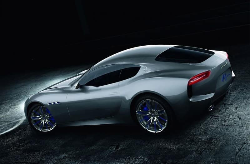 silver Maserati Alfieri concept car, a two-door luxury sports car parked on cracked pavement