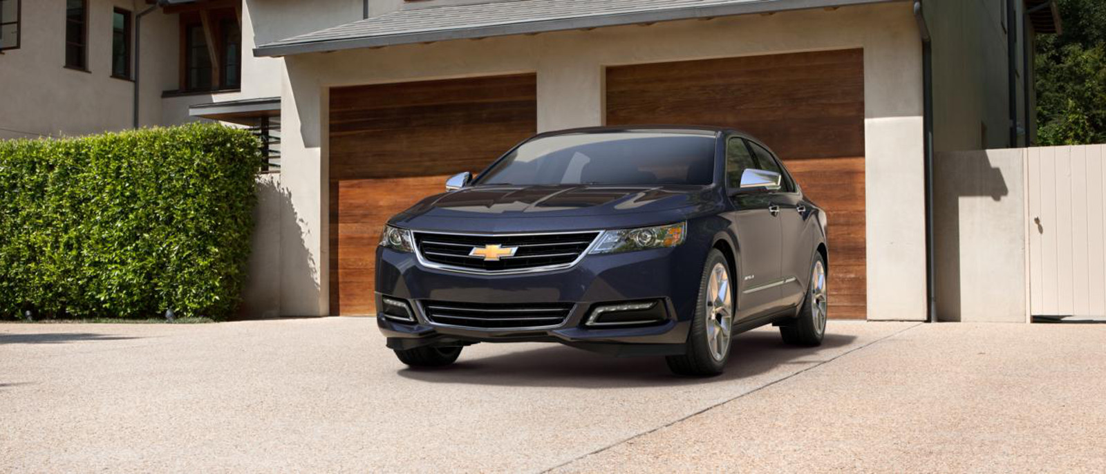 2015 Chevrolet Impala parked by garage