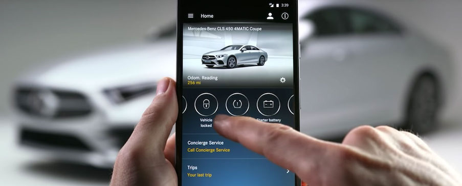 Man using Mercedes me app
