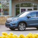 2018 Honda Pilot Elite parked near flowers