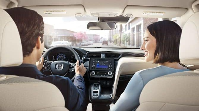 Couple Driving 2019 Honda Insight
