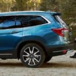 Blue 2021 Honda Pilot SUV with dad and son loading trunk using hands-free cargo liftgate